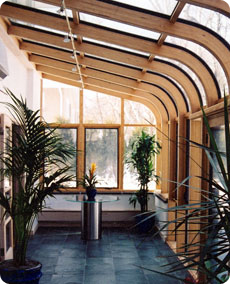 Curved eave sunrooms